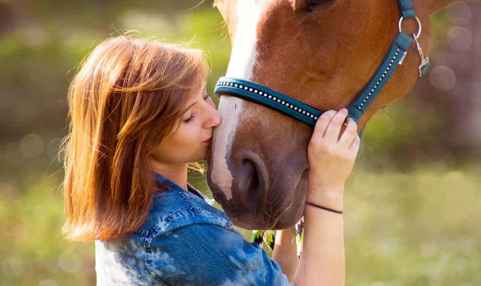 a girl kissing her horse: best things to do