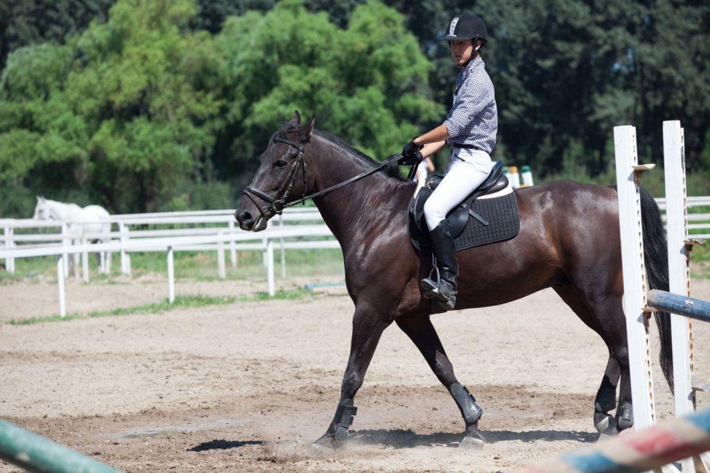 a boy riding a horse