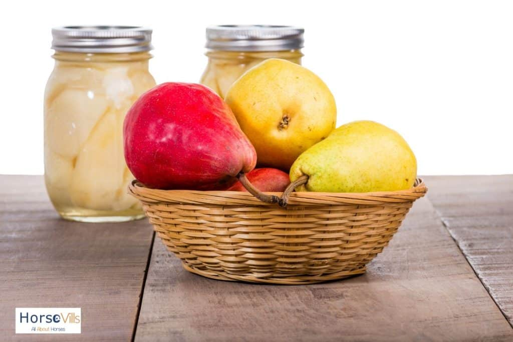 fresh pears in a basket and canned pears