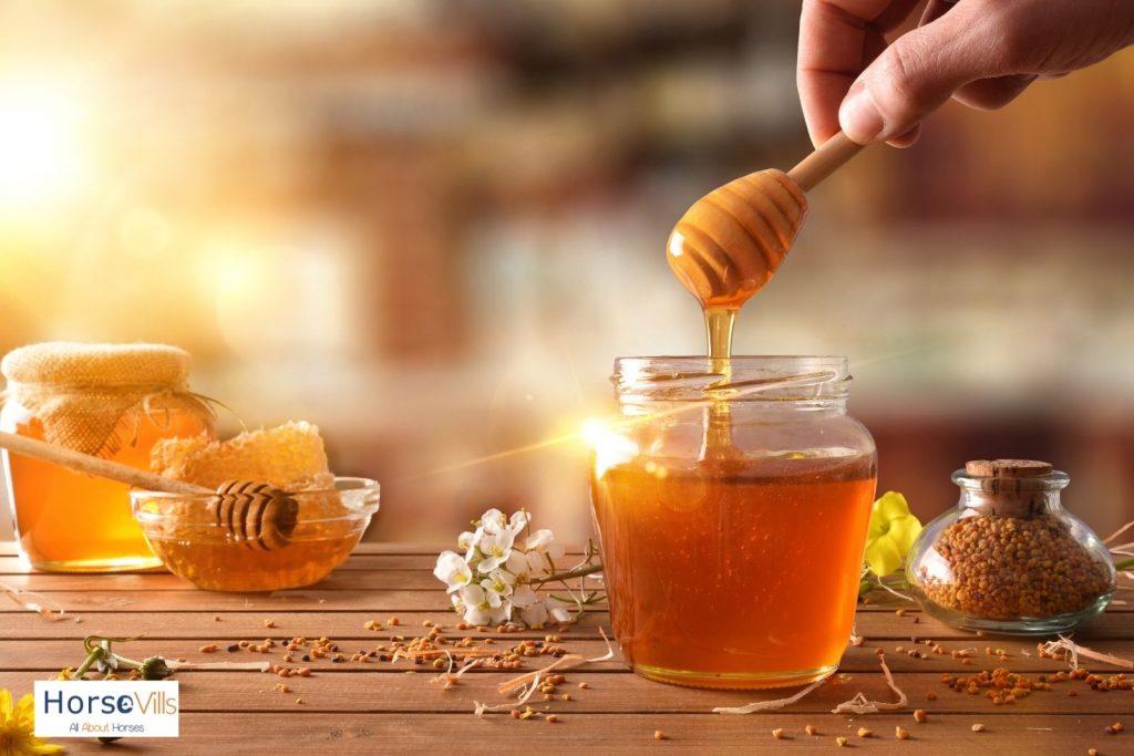 fresh honey in transparent jars